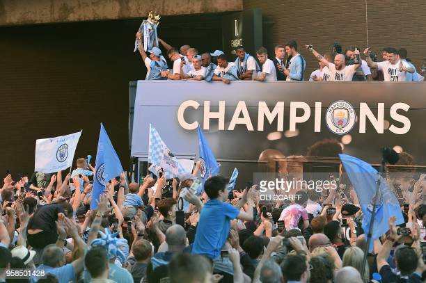 Manchester City's Argentinian defender Nicolas Otamendi holds up the Premier League trophy to fans as the Manchester City team take part in an...
