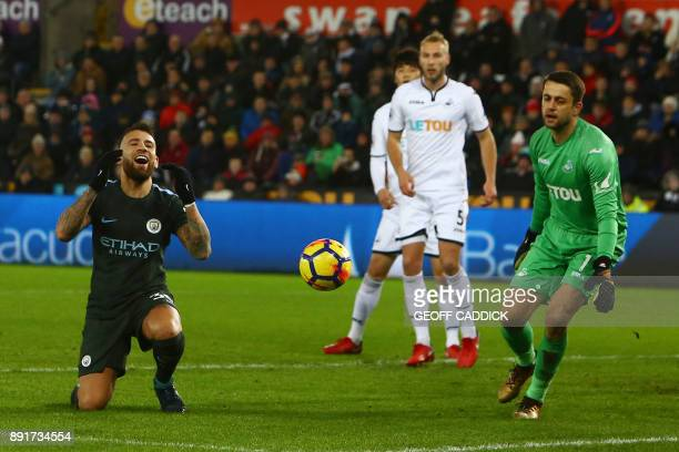 Manchester City's Argentinian defender Nicolas Otamendi misses a shot on goal during the English Premier League football match between Swansea City...