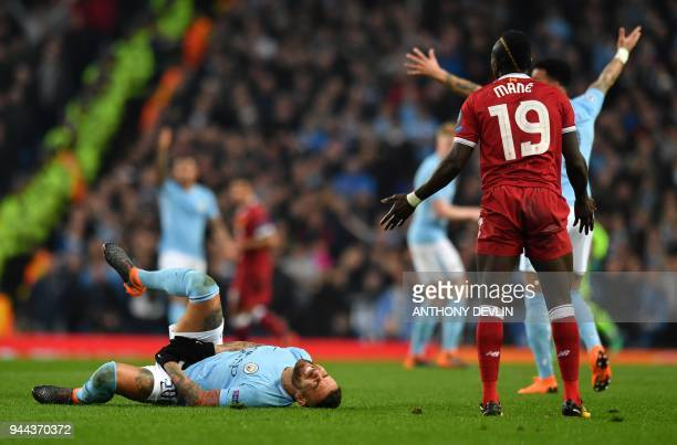Manchester City's Argentinian defender Nicolas Otamendi reacts follwing a challenge by Liverpool's Senegalese midfielder Sadio Mane during the UEFA...