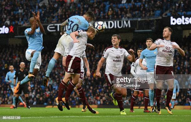 TOPSHOT Manchester City's Argentinian defender Nicolas Otamendi scores his team's second goal during the English Premier League football match...