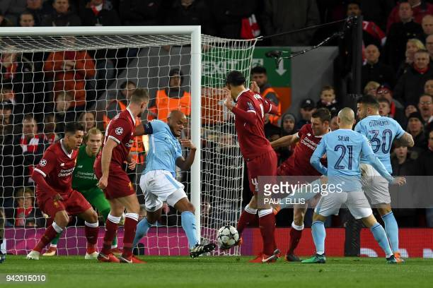 Manchester City's Argentinian defender Nicolas Otamendi takes a shot during the UEFA Champions League first leg quarterfinal football match between...