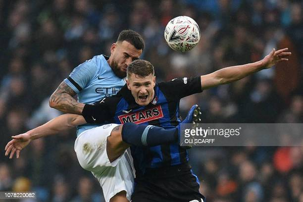 TOPSHOT Manchester City's Argentinian defender Nicolas Otamendi vies with Rotherham's English striker Michael Smith during the English FA Cup third...