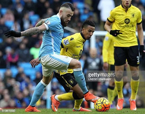 Manchester City's Argentinian defender Nicolas Otamendi vies with Aston Villa's English midfielder Scott Sinclair during the English Premier League...