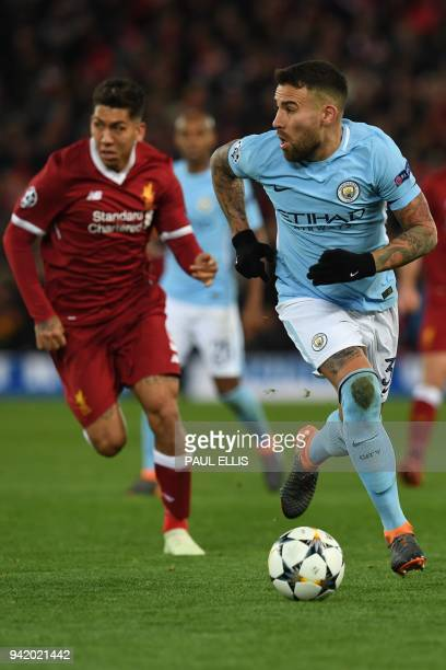 Manchester City's Argentinian defender Nicolas Otamendi vies with Liverpool's Brazilian midfielder Roberto Firmino during the UEFA Champions League...