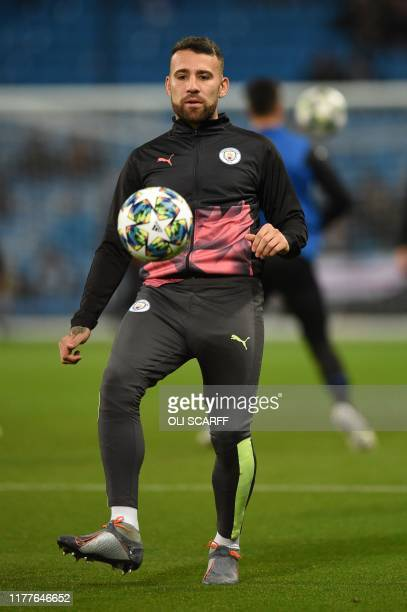 Manchester City's Argentinian defender Nicolas Otamendi warms up for the UEFA Champions League Group C football match between Manchester City and...