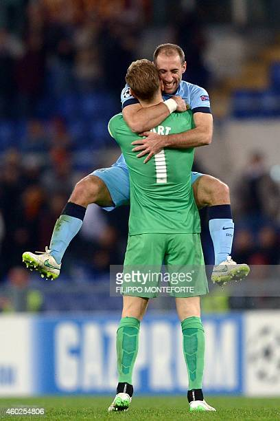 Manchester City's Argentinian defender Pablo Zabaleta celebrates with Manchester City's English goalkeeper Joe Hart after winning 02 the end of the...