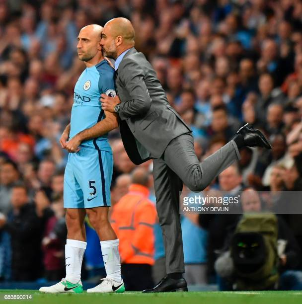 TOPSHOT Manchester City's Argentinian defender Pablo Zabaleta gets final instructions from Manchester City's Spanish manager Pep Guardiola as he...