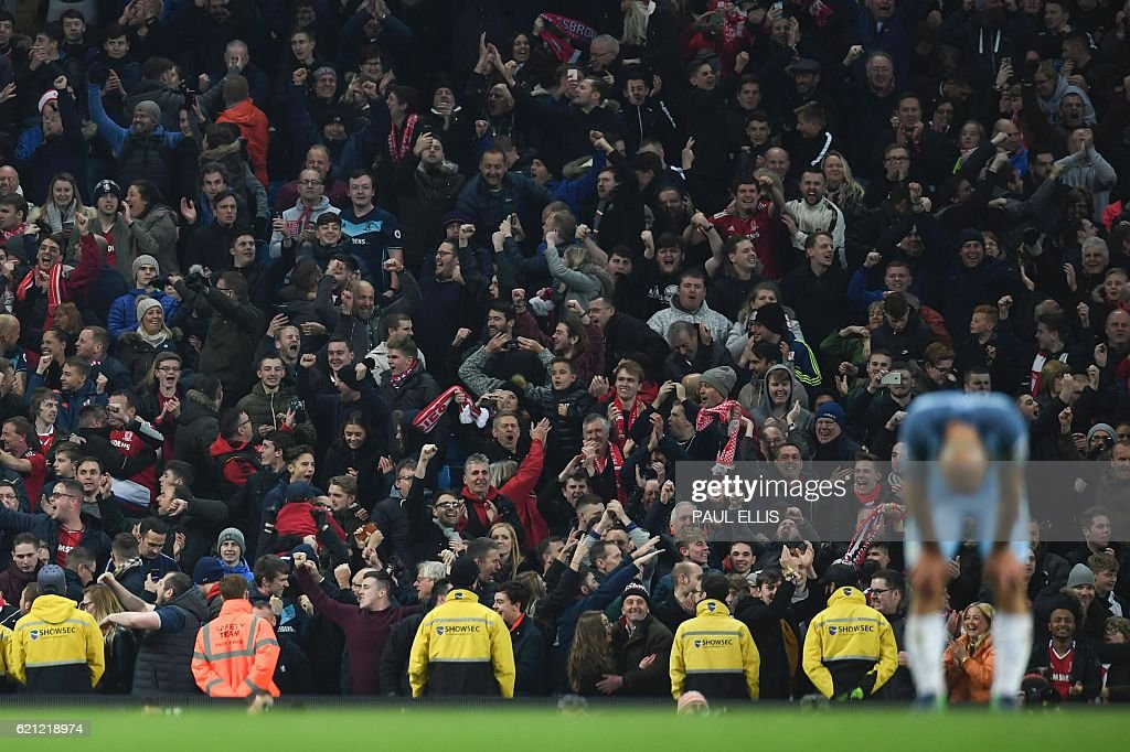 Manchester City's Argentinian defender Pablo Zabaleta (R) reacts as Middlesbrough fans celebrate at the end of the English Premier League football match between Manchester City and Middlesbrough at the Etihad Stadium in Manchester, north west England, on November 5, 2016. / AFP / PAUL ELLIS / RESTRICTED TO EDITORIAL USE. No use with unauthorized audio, video, data, fixture lists, club/league logos or 'live' services. Online in-match use limited to 75 images, no video emulation. No use in betting, games or single club/league/player publications. /