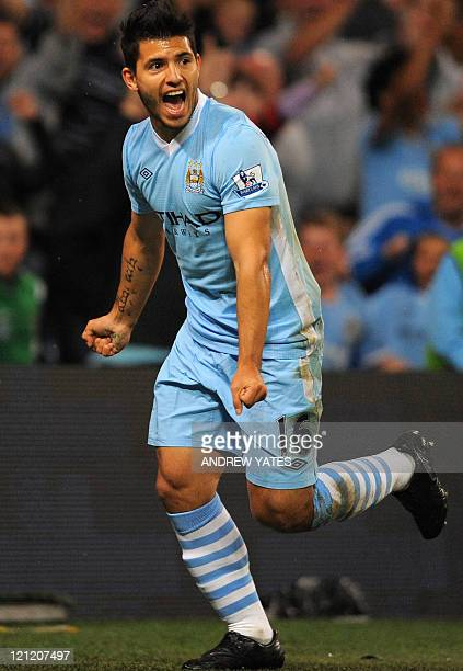 Manchester City's Argentinian forward Sergio Agüero celebrates after scoring during the English Premier League football match between Manchester City...