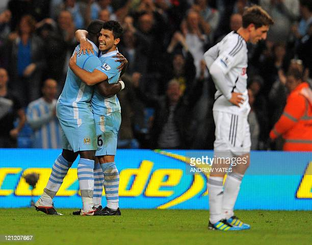 Manchester City's Argentinian forward Sergio Agüero celebrates with Manchester City's English defender Micah Richards after scoring the fourth goal...