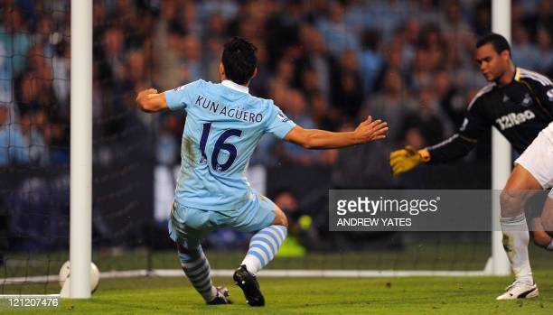 Manchester City's Argentinian forward Sergio Agüero scores during the English Premier League football match between Manchester City and Swansea at...