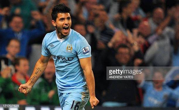 Manchester City's Argentinian forward Sergio Aguero celebrates after scoring during the English Premier League football match between Manchester City...
