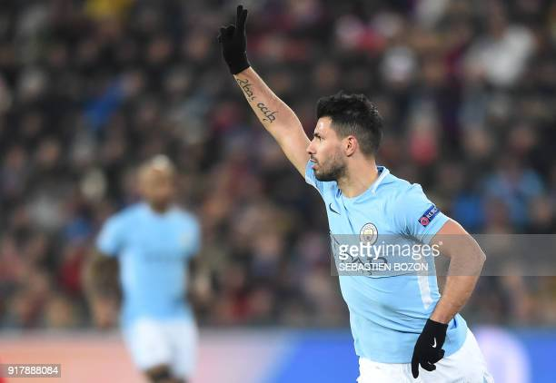 Manchester City's Argentinian forward Sergio Aguero celebrates after scoring a goal during the UEFA Champions League round of 16 first leg football...