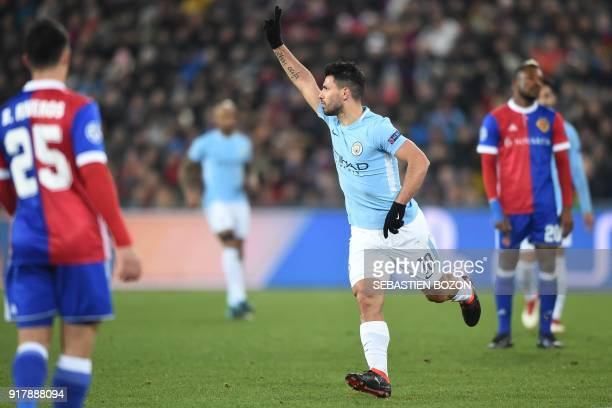 TOPSHOT Manchester City's Argentinian forward Sergio Aguero celebrates after scoring a goal during the UEFA Champions League round of 16 first leg...