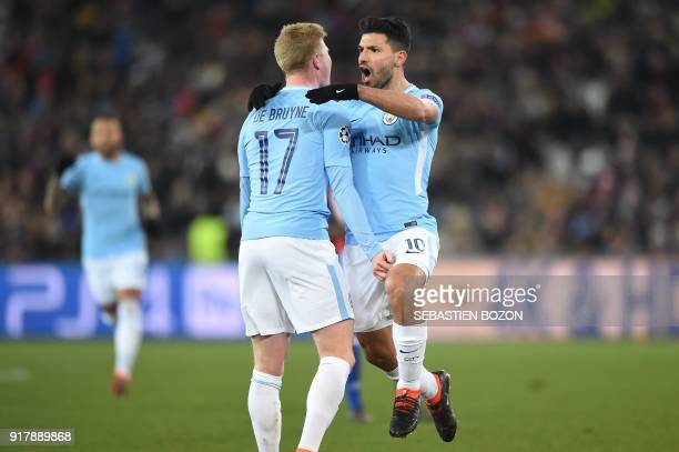 Manchester City's Argentinian forward Sergio Aguero celebrates with Manchester City's Belgian midfielder Kevin De Bruyne after scoring a goal during...