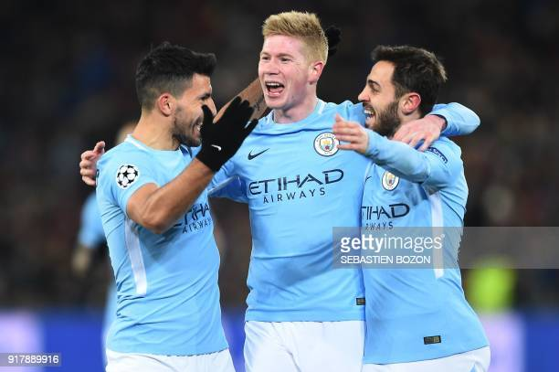 Manchester City's Argentinian forward Sergio Aguero celebrates with Manchester City's Belgian midfielder Kevin De Bruyne and Manchester City's...