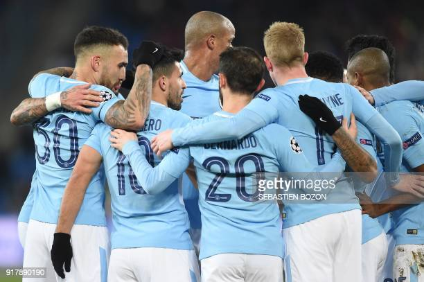 Manchester City's Argentinian forward Sergio Aguero celebrates with teammates after scoring a goal during the UEFA Champions League round of 16 first...