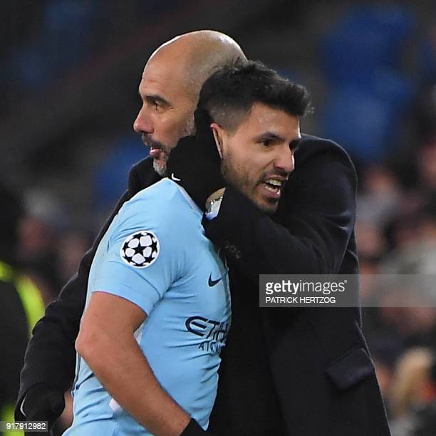 Manchester City's Argentinian forward Sergio Aguero is congratlated by Manchester City's Spanish head coach Pep Guardiola during during the UEFA...