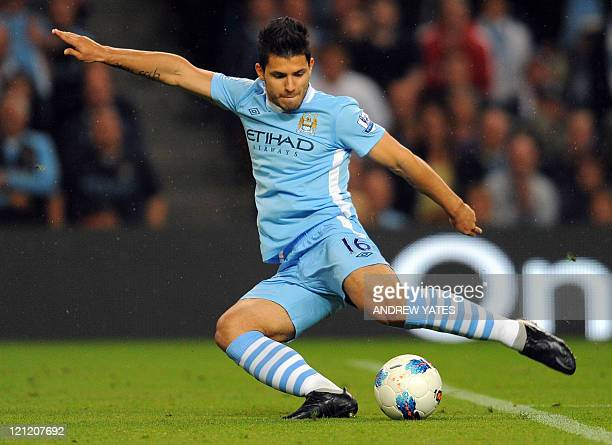 Manchester City's Argentinian forward Sergio Aguero shoots during the English Premier League football match between Manchester City and Swansea at...