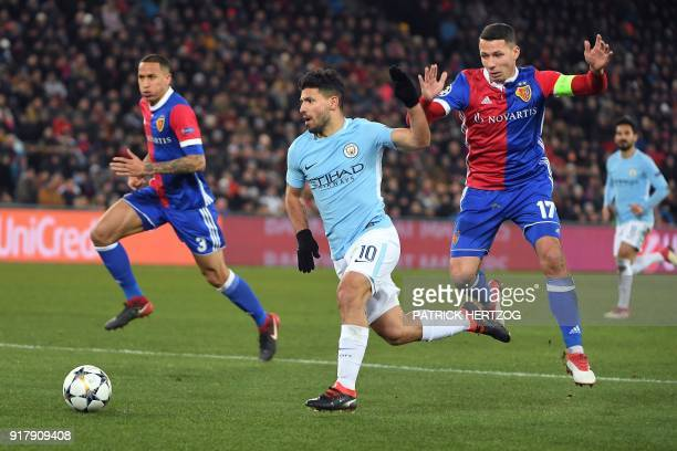 Manchester City's Argentinian forward Sergio Aguero vies for the ball with Basel's Czech defender Marek Suchy during the UEFA Champions League round...