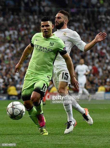 Manchester City's Argentinian forward Sergio Aguero vies with Real Madrid's defender Dani Carvajal during the UEFA Champions League semi-final second...