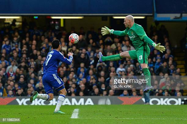 Manchester CIty's Argentinian goalkeeper Willy Caballero leaps as Chelsea's Spanish midfielder Pedro goes through but is ruled offside during the...