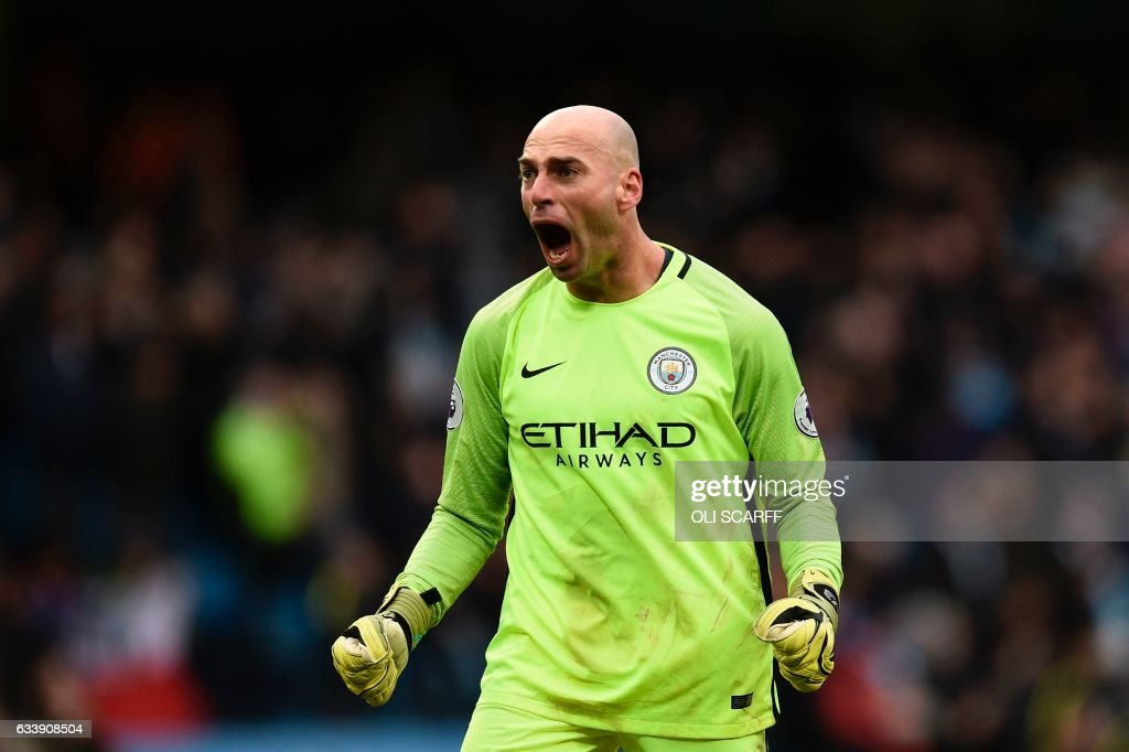 Manchester CIty's Argentinian goalkeeper Willy Caballero reacts to their late winning goal during the English Premier League football match between Manchester City and Swansea City at the Etihad Stadium in Manchester, north west England, on February 5, 2017. Manchester City won the game 2-1. / AFP PHOTO / Oli SCARFF / RESTRICTED TO EDITORIAL USE. No use with unauthorized audio, video, data, fixture lists, club/league logos or 'live' services. Online in-match use limited to 75 images, no video emulation. No use in betting, games or single club/league/player publications. /