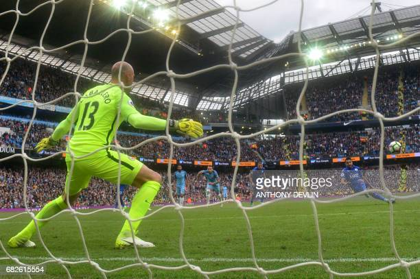 Manchester City's Argentinian goalkeeper Willy Caballero stands by as Leicester City's Algerian midfielder Riyad Mahrez takes his penalty which hit...