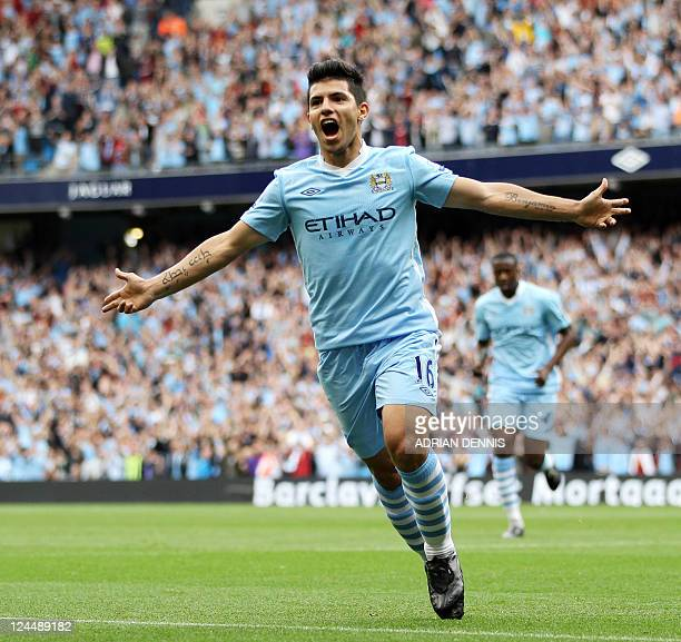 Manchester City's Argentinian player Sergio Aguero celebrates scoring the opening goal against Wigan Athletic during the Premiership football match...