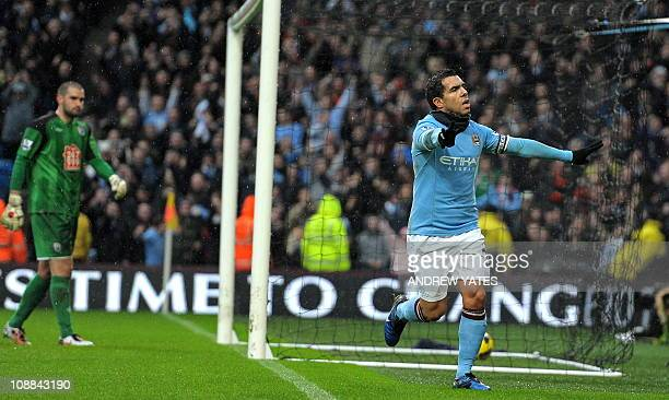 Manchester City's Argentinian striker Carlos Tevez celebrates scoring his third goal from the penalty spot as West Bromwich's US goalkeeper Boaz...