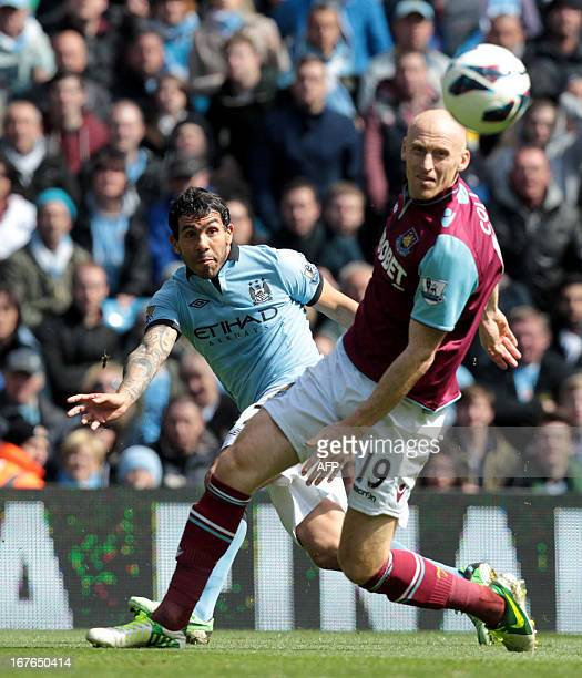 Manchester City's Argentinian striker Carlos Tevez shoots the ball past West Ham United's Welsh defender James Collins during the English Premier...