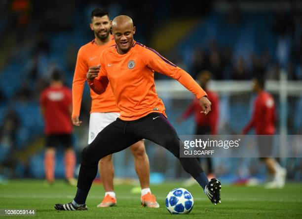 Manchester City's Argentinian striker Sergio Aguero and Manchester City's Belgian defender Vincent Kompany warm up before the UEFA Champions League...