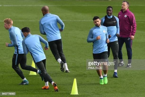 Manchester City's Argentinian striker Sergio Aguero and Manchester City's French defender Benjamin Mendy attend a training session with teammates...