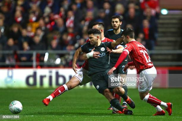 Manchester City's Argentinian striker Sergio Aguero battles against tight marking during the English League Cup semifinal second leg football match...