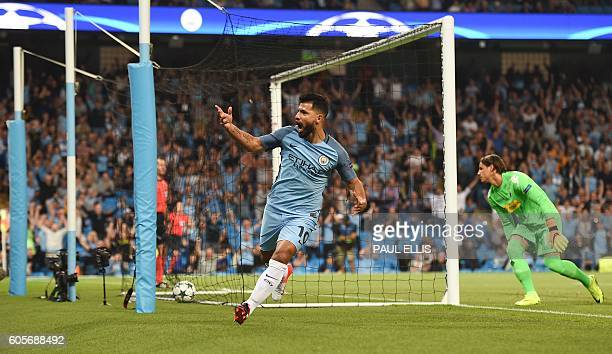 Manchester City's Argentinian striker Sergio Aguero celebrates after scoring the opening goal during the UEFA Champions League group C football match...