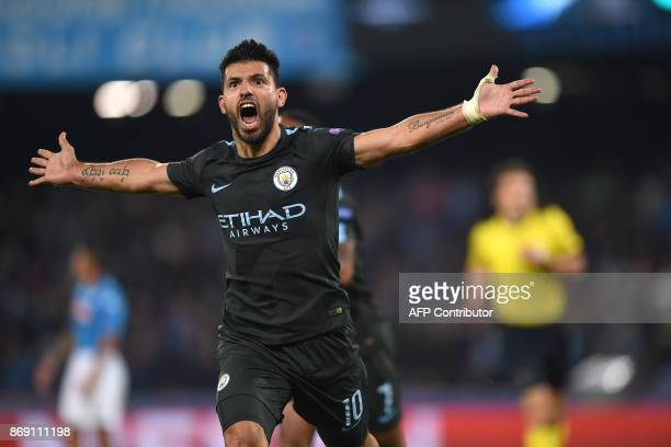 TOPSHOT Manchester City's Argentinian striker Sergio Aguero celebrates after scoring during the UEFA Champions League football match Napoli vs...