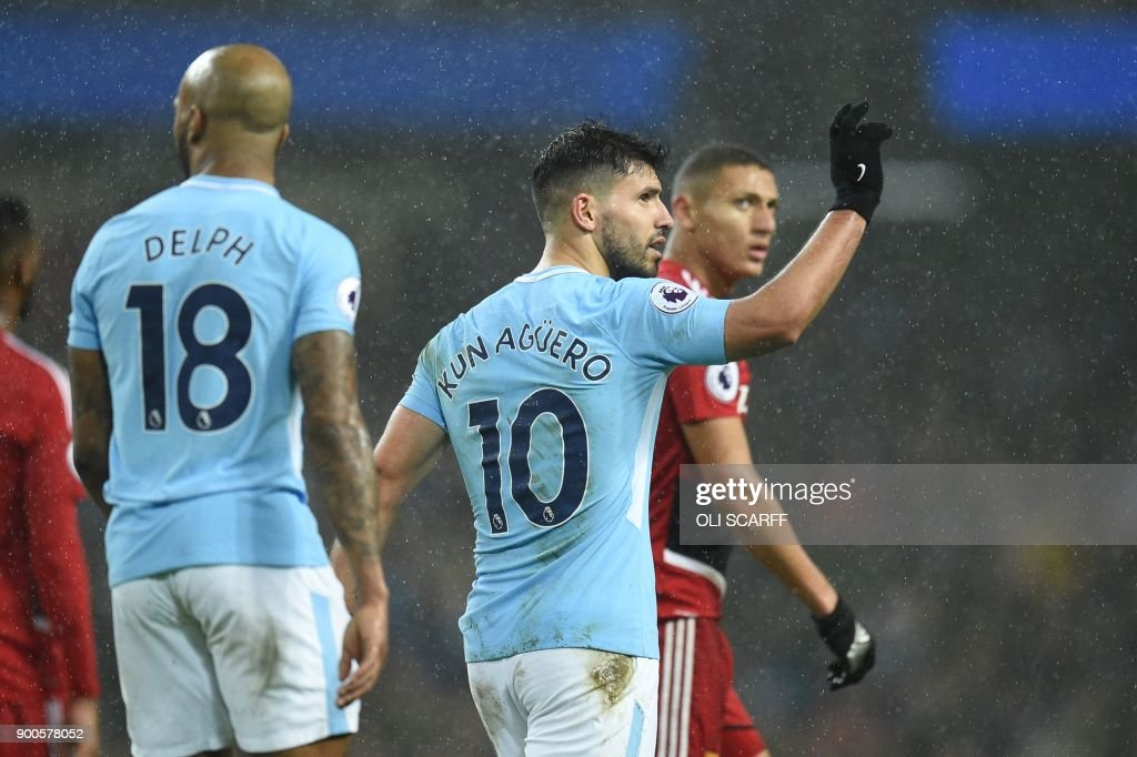 Manchester City's Argentinian striker Sergio Aguero celebrates after scoring their third goal during the English Premier League football match between Manchester City and Watford at the Etihad Stadium in Manchester, north west England, on January 2, 2018. / AFP PHOTO / Oli SCARFF / RESTRICTED TO EDITORIAL USE. No use with unauthorized audio, video, data, fixture lists, club/league logos or 'live' services. Online in-match use limited to 75 images, no video emulation. No use in betting, games or single club/league/player publications. /