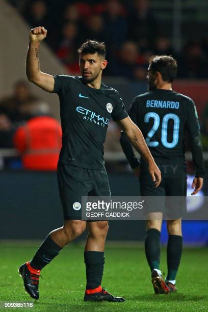 Manchester City's Argentinian striker Sergio Aguero celebrates after scoring their second goal during the English League Cup semifinal second leg...