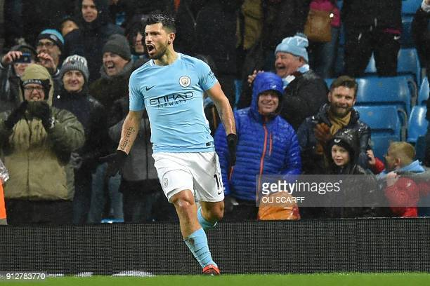 Manchester City's Argentinian striker Sergio Aguero celebrates after scoring their third goal during the English Premier League football match...
