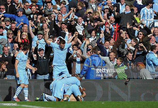 Manchester City's Argentinian striker Sergio Aguero celebrates his late winning goal with teammates during the English Premier League football match...