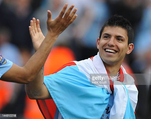 Manchester City's Argentinian striker Sergio Aguero celebrates on the pitch after their 32 victory over Queens Park Rangers in the English Premier...