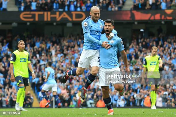 Manchester City's Argentinian striker Sergio Aguero celebrates scoring the opening goal with Manchester City's Spanish midfielder David Silva during...
