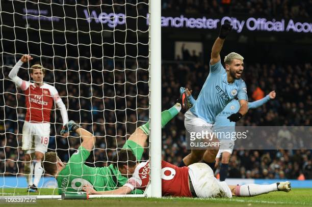 Manchester City's Argentinian striker Sergio Aguero celebrates scoring their third goal to complete his hattrick during the English Premier League...