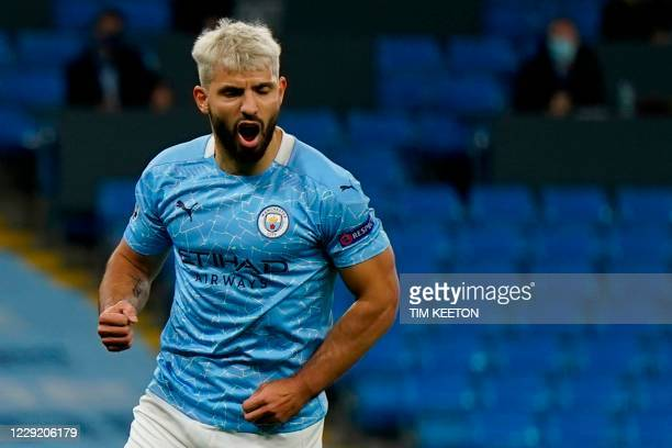 Manchester City's Argentinian striker Sergio Aguero celebrates scoring their first goal from the penalty spot to equalise 1-1 during the UEFA...