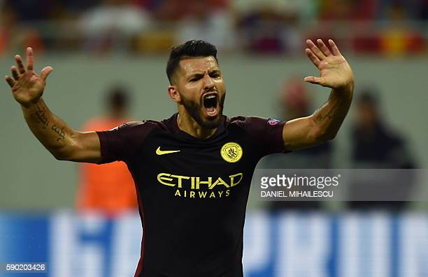 Manchester City's Argentinian striker Sergio Aguero celebrates scoring a goal during the UEFA Champions league first leg playoff football match...