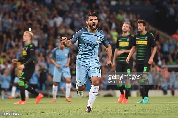 Manchester City's Argentinian striker Sergio Aguero celebrates scoring their second goal from a penalty during the UEFA Champions League group C...