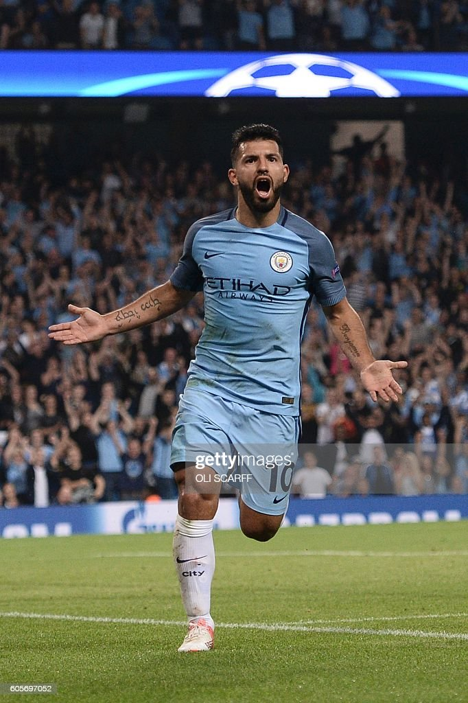 Manchester City's Argentinian striker Sergio Aguero celebrates scoring their third goal and completing his hattrick during the UEFA Champions League group C football match between Manchester City and Borussia Monchengladbach at the Etihad stadium in Manchester, northwest England, on September 14, 2016. / AFP / OLI