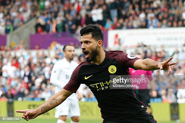 Manchester City's Argentinian striker Sergio Aguero celebrates scoring the opening goal during the English Premier League football match between...