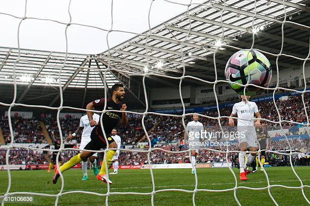 Manchester City's Argentinian striker Sergio Aguero celebrates scoring their second goal from the penalty spot during the English Premier League...