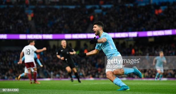 Manchester City's Argentinian striker Sergio Aguero celebrates scoring their first goal to equalise 11 during the English FA Cup third round football...